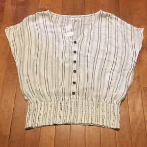 White with black striped V-neck shirt